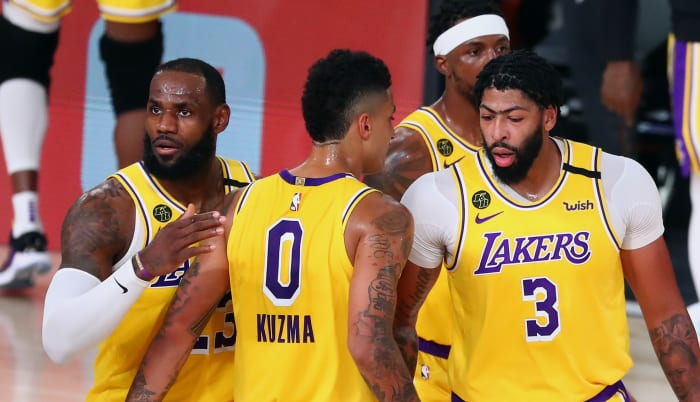 Los Angeles Lakers forward LeBron James (23) controls the ball against Portland Trail Blazers guard Gary Trent Jr. (left) during the first half of a NBA basketball first round playoff game