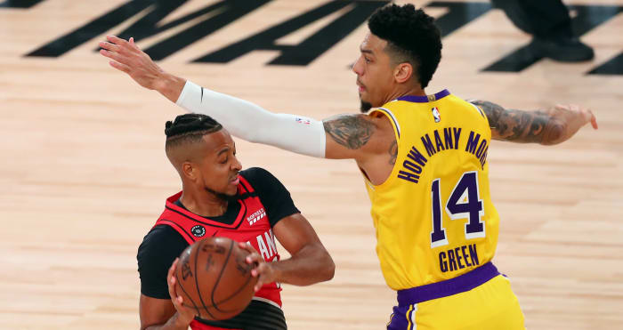 Portland Trail Blazers guard CJ McCollum (3) controls the ball against Los Angeles Lakers guard Danny Green (14) during the first half of a NBA basketball first round playoff gam