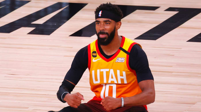 Mike Conley #10 of the Utah Jazz reacts after being fouled against the Denver Nuggets during the third quarter in Game Three of the Western Conference First Round during the 2020 NBA Playoffs
