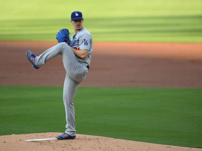 Walker Buehler prepares to throw a pitch