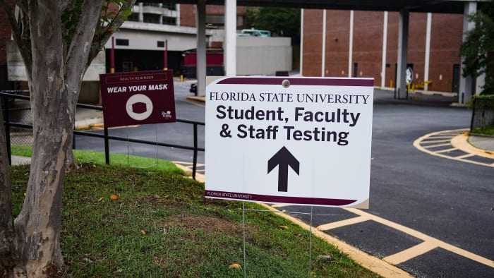 A sign for COVID-19 testing on FSU's campus