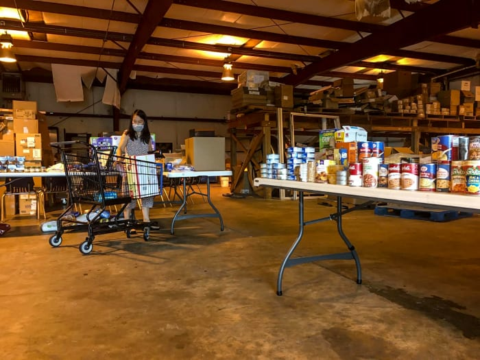 McNeese cleared out a warehouse on campus to house donations. This past Tuesday, a woman shops for items.