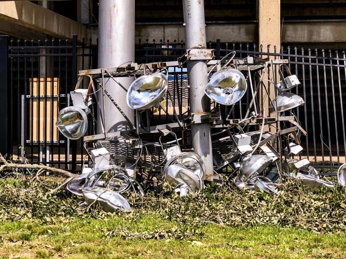 A crushed light fixture outside Cowboy Stadium