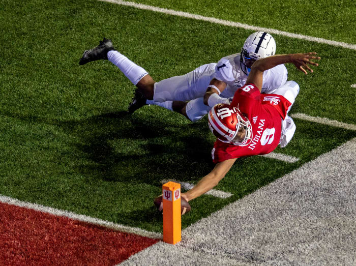 Michael Penix Jr.  dived for the pole to beat Penn State in extra time last season at Memorial Stadium.