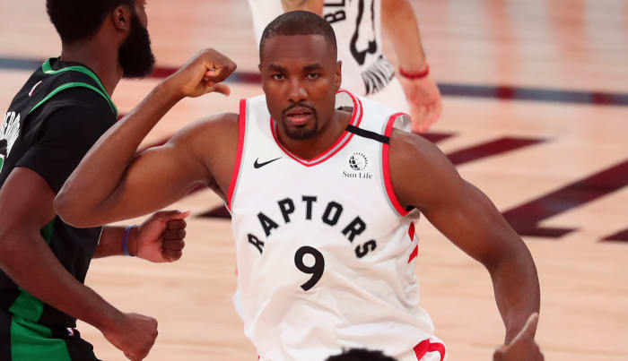 Toronto Raptors center Serge Ibaka (9) reacts after making a basket