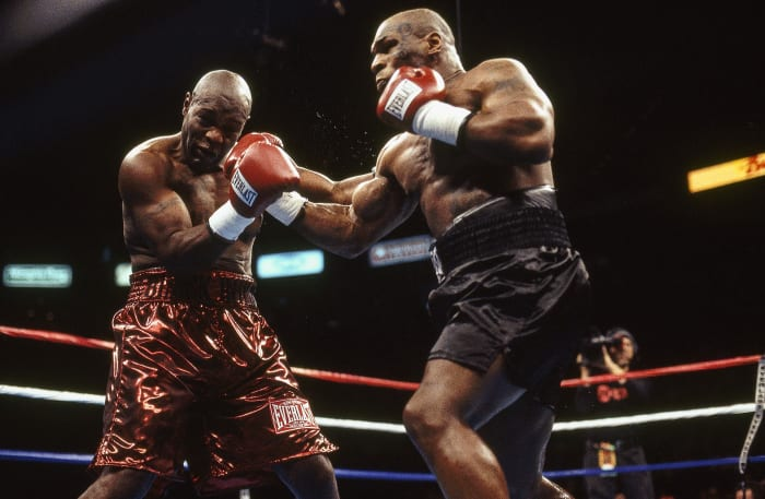 Etienne was still climbing when he met a freshly tattooed Tyson in February 2003.