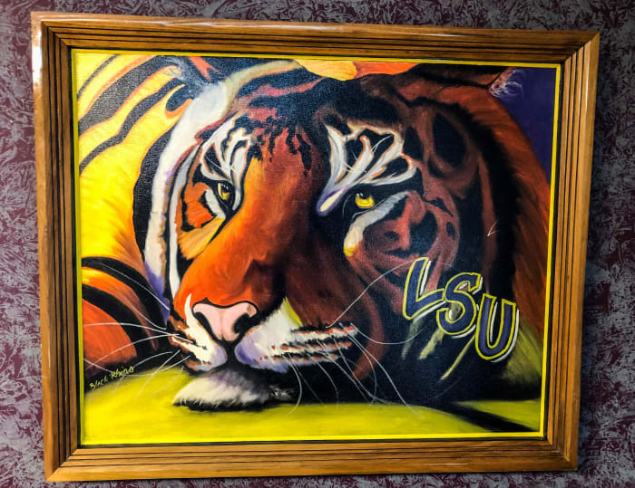 The Black Rhino's tiger adorns his lawyer's office wall in New Iberia.