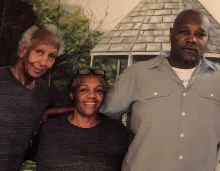 Clifford (far right) with his mother, Emily, and father, Clifford Sr., atElayn Hunt.