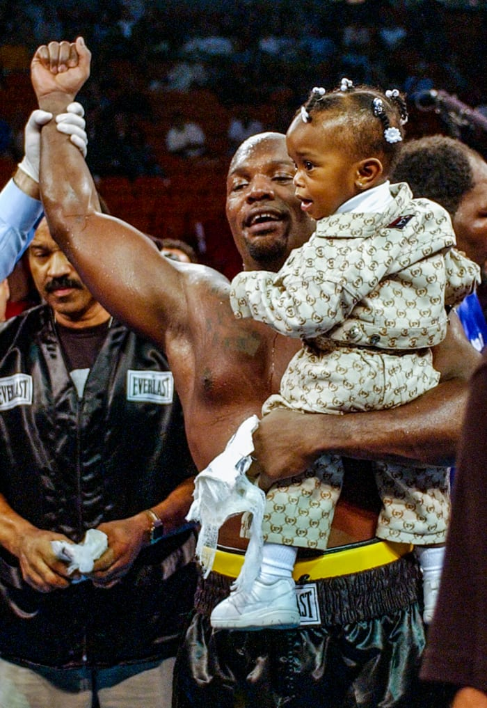 The Black Rhino and his daughter, Jacol'e, in February 2002, after a seventh-round TKO of Gabe Brown.