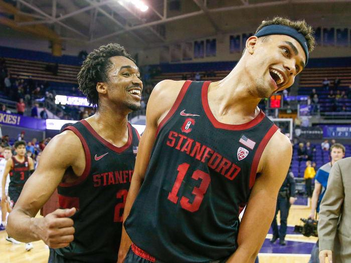 Stanford Cardinal forward Oscar da Silva (13) and guard Bryce Wills (2) celebrate a win in 2019.