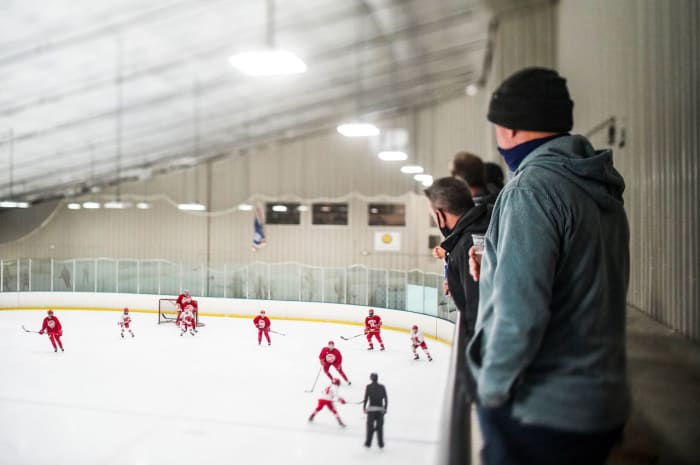 Invested moms and dads watch over their hopeful teens at Brewster Ice Arena, outside New York City.
