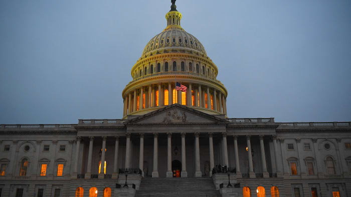The United States Capitol is seen at dusk