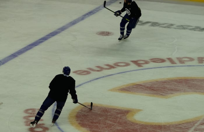 Mikko Lehtonen (left) skating with Zach Bogosian (partially cut off).