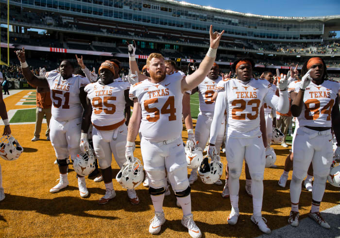 Texas Longhorns offensive lineman Terrell Cuney (51) and defensive lineman Poona Ford (95) and offensive lineman Garrett Graf (54) and defensive back Jordan Strickland (23) and wide receiver Lil'Jordan Humphrey (84) celebrate the win over the Baylor Bears at McLane Stadium. The Longhorns defeat the Bears 38-7. © Jerome Miron-USA TODAY Sports