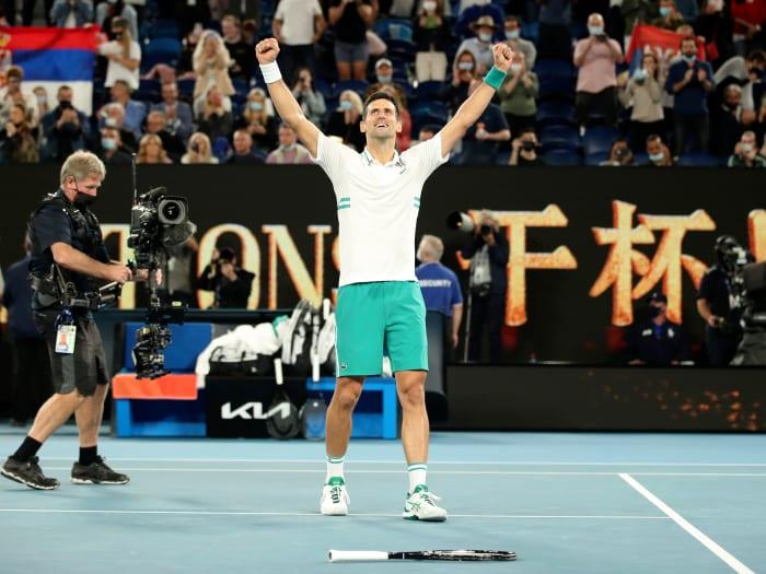 Serbia's Novak Djokovic celebrates after winning the men's singles final against Russia's Daniil Medvedev at Australian Open in Melbourne Park in Melbourne, Australia, Feb. 21, 2021.