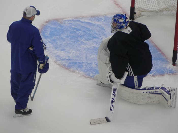 Leafs goaltender Frederik Andersen (right) stretching it out with Leafs goaltender coach Steve Briere (left)