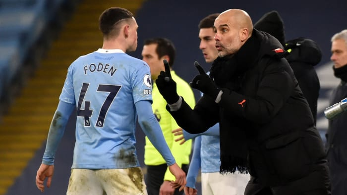 Manchester City's Phil Foden and Pep Guardiola