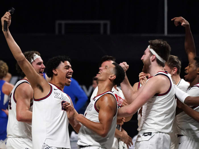 Gonzaga celebrates beating BYU in the WCC tournament.