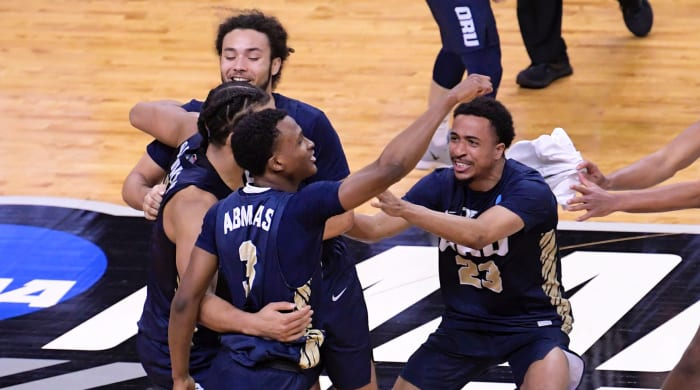 Oral Roberts Golden Eagles celebrate their 81-78 victory over the Florida Gators during the second round of the 2021 NCAA Tournament on Sunday, March 21, 2021.