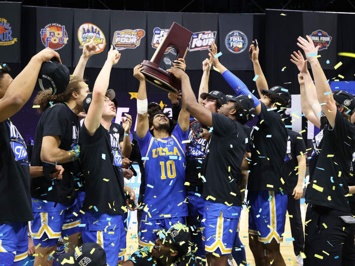 UCLA celebrates with its Eastern Region trophy