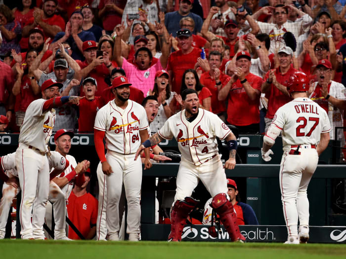 Sep 18, 2021; St. Louis, Missouri, USA; St. Louis Cardinals left fielder Tyler O'Neill (27) is congratulated after hitting a two-run home run against the San Diego Padres during the eighth inning at Busch Stadium.