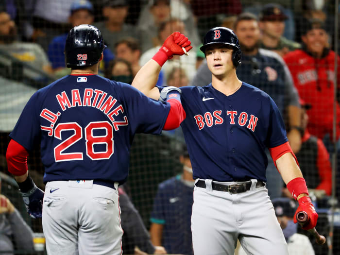 Sep 14, 2021; Seattle, Washington, USA; Boston Red Sox left fielder J.D. Martinez (28) celebrates his solo home run with Boston Red Sox first baseman Bobby Dalbec (29) against the Seattle Mariners in the fourth inning at T-Mobile Park.