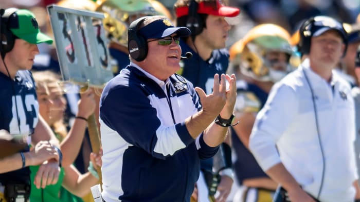Notre Dame coach Brian Kelly on the bench against Wisconsin