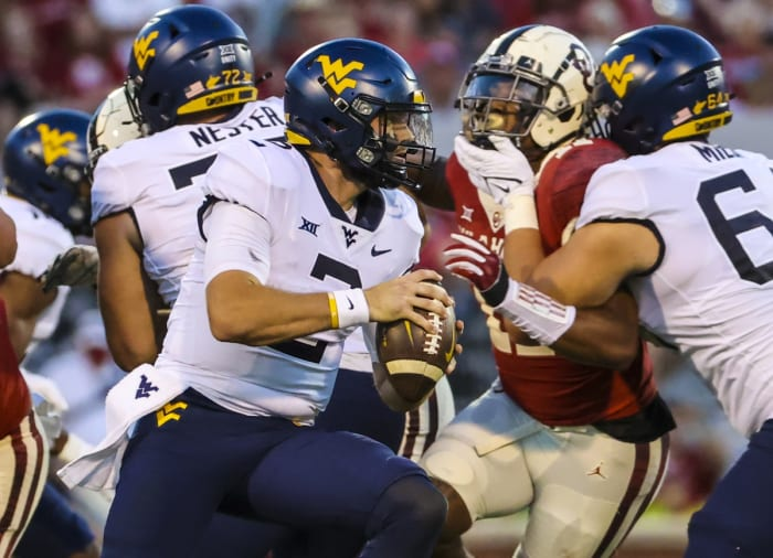 Sep 25, 2021; Norman, Oklahoma, USA; West Virginia Mountaineers quarterback Jarret Doege (2) throws during the first half against the Oklahoma Sooners at Gaylord Family-Oklahoma Memorial Stadium. Mandatory Credit: Kevin Jairaj-USA TODAY Sports