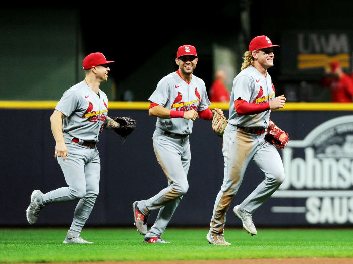 September 20, 2021;  Milwaukee, Wisconsin, United States;  St. Louis Cardinals left fielder Tyler O'Neill (27) and right fielder Dylan Carlson (3) and center fielder Harrison Bader (48) celebrate after defeating the Milwaukee Brewers at American Family Field.