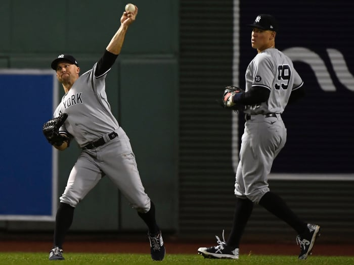 New York Yankees center fielder Brett Gardner (11) throws after playing for the only shot by Boston Red Sox right fielder Hunter Renfroe (10) during the fourth inning of the AL generic card game.