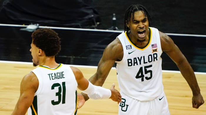 Baylor Bears guard Davion Mitchell (45) celebrates with guard MaCio Teague (31)