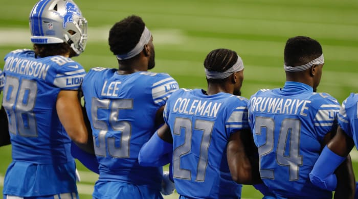Detroit Lions players are arm in arm