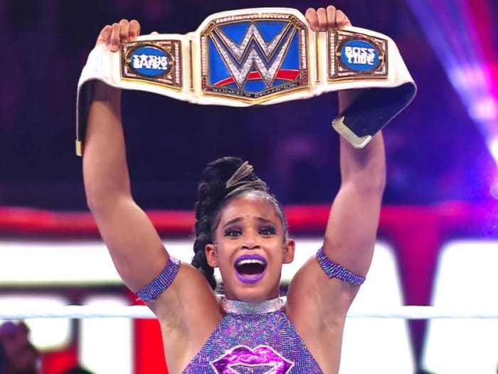Bianca Belair holds the belt at WrestleMania 37