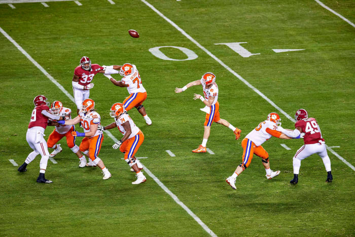 Trevor Lawrence throws a pass against Alabama in the national title game his freshman year at Clemson