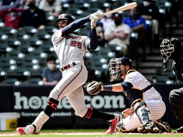 April 4, 2021;  Milwaukee, Wisconsin, United States;  Minnesota Twins center fielder Byron Buxton (25) hits a double in the first inning as Milwaukee Brewers wide receiver Manny Pina (9) watches at American Family Field.