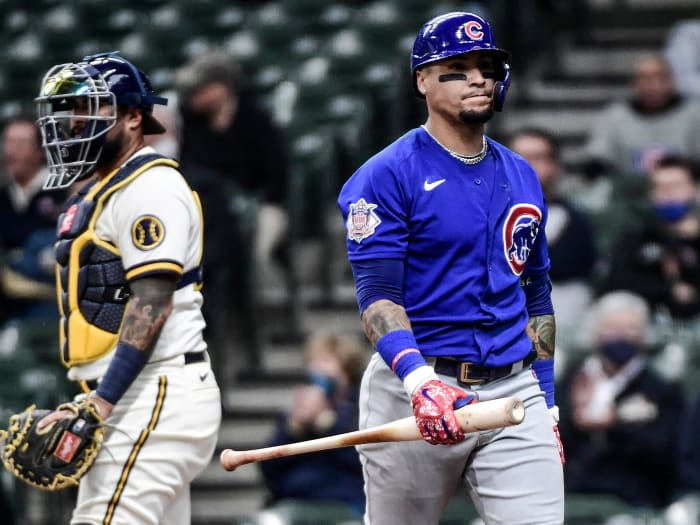 April 14, 2021;  Milwaukee, Wisconsin, United States;  Chicago Cubs shortstop Javier Baez (9) returns to the dugout after striking out in the fourth inning during the game against the Milwaukee Brewers at American Family Field.