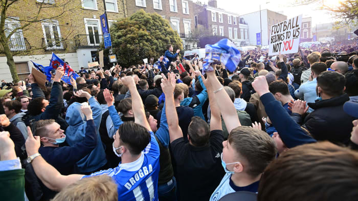 Chelsea fans celebrate the club's withdrawal from the Super League