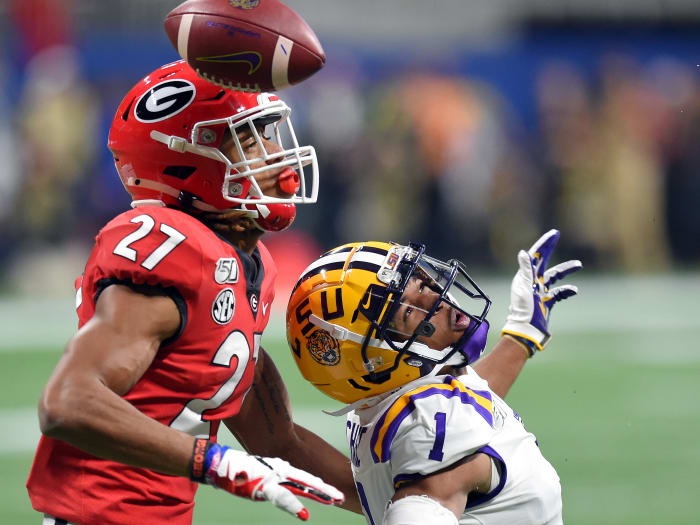Georgia Bulldogs defensive back Eric Stokes (27) interrupts a pass intended for LSU Tigers wide receiver Ja'Marr Chase (1) during the first quarter of the 2019 SEC Championship Game.