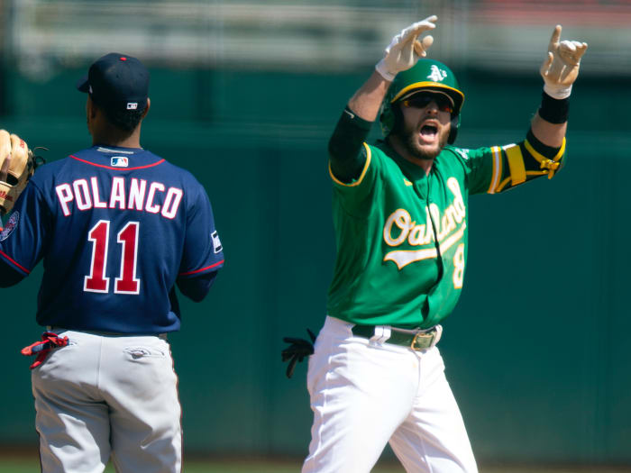 Oakland Athletics Jed Lowrie (8) celebrates his two-run double