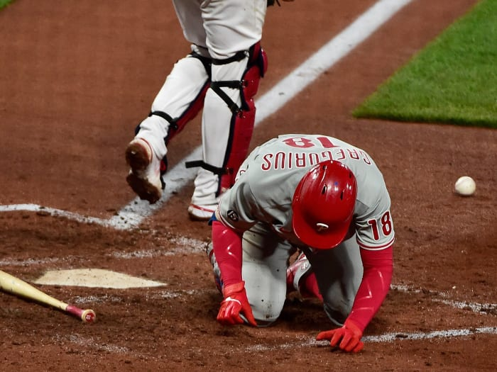 Philadelphia Phillies shortstop Didi Gregorius (18) falls to the ground after he was hit by a pitch from St. Louis Cardinals relief pitcher Genesis Cabrera