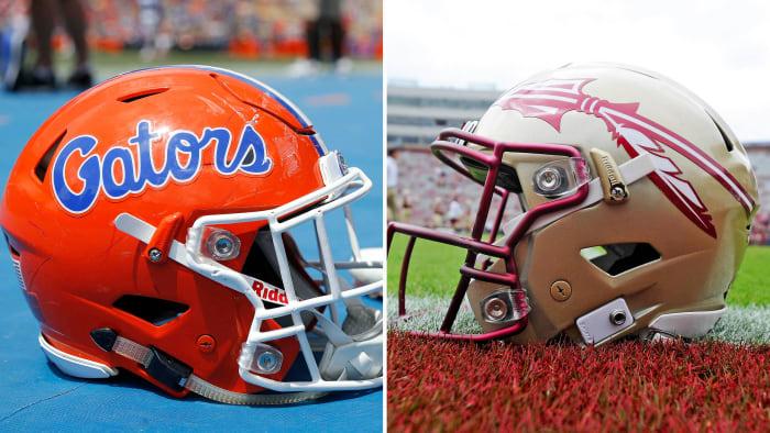 Florida and FSU football helmets sit on the ground