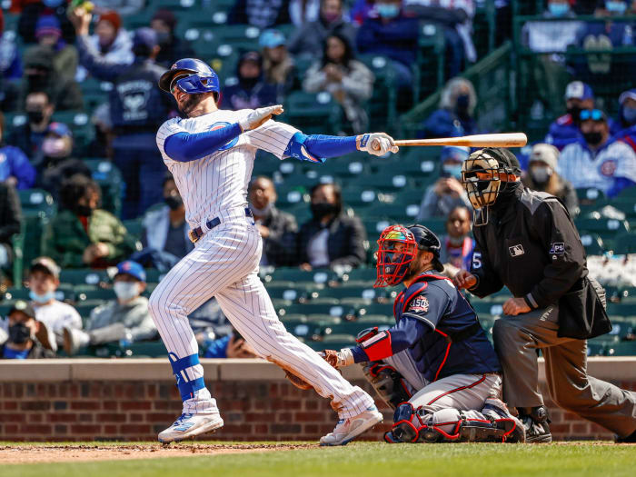April 17, 2021;  Chicago, Illinois, United States;  Chicago Cubs third baseman Kris Bryant (17) hits a two-run homer against the Atlanta Braves during the fifth inning at Wrigley Field.