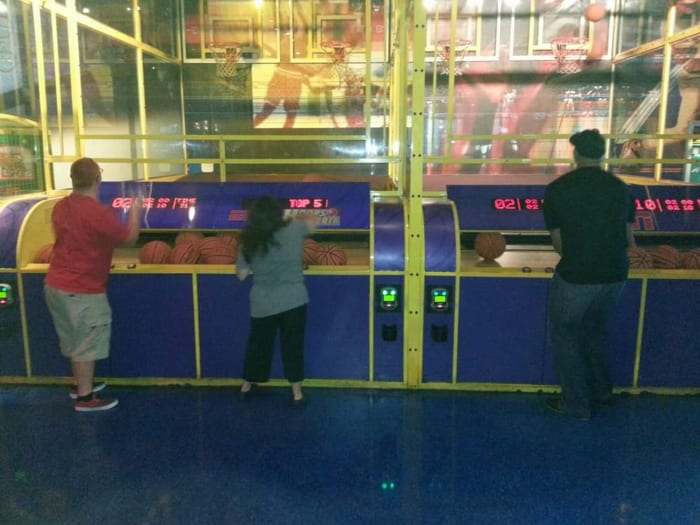 Albert Pujols plays pop-a-shot basketball with Alex Turchowski and his friend Nate.