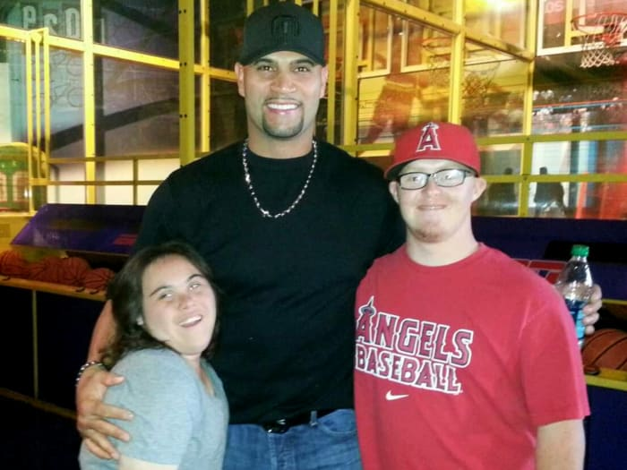 Albert Pujols with Alex Turchowski (left) and his friend Nate on ESPN Zone
