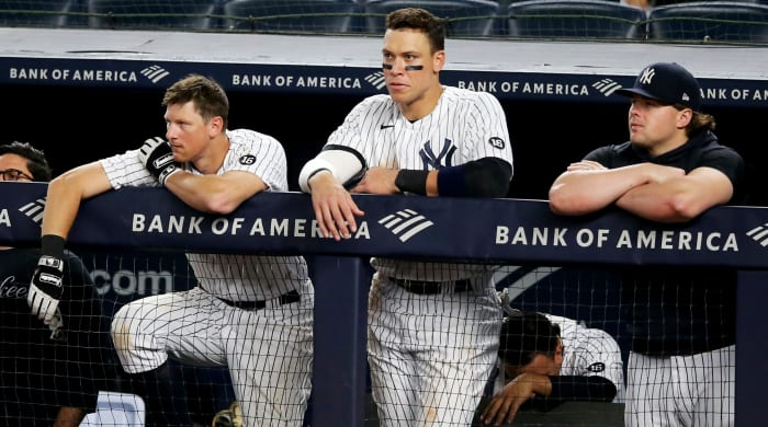 Jun 4, 2021; Bronx, New York, USA; New York Yankees first baseman DJ LeMahieu (26) and right fielder Aaron Judge (99) and injured first baseman Luke Voit (59) look on from the dugout during the ninth inning against the Boston Red Sox at Yankee Stadium.