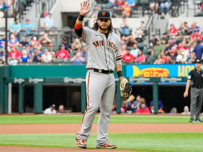 Jun 8, 2021; Arlington, Texas, USA; San Francisco Giants shortstop Brandon Crawford (35) is recognized as he takes the field for his 1,326th appearance at shortstop, setting a new record for the Giants, during the first inning against the Texas Rangers at Globe Life Field.