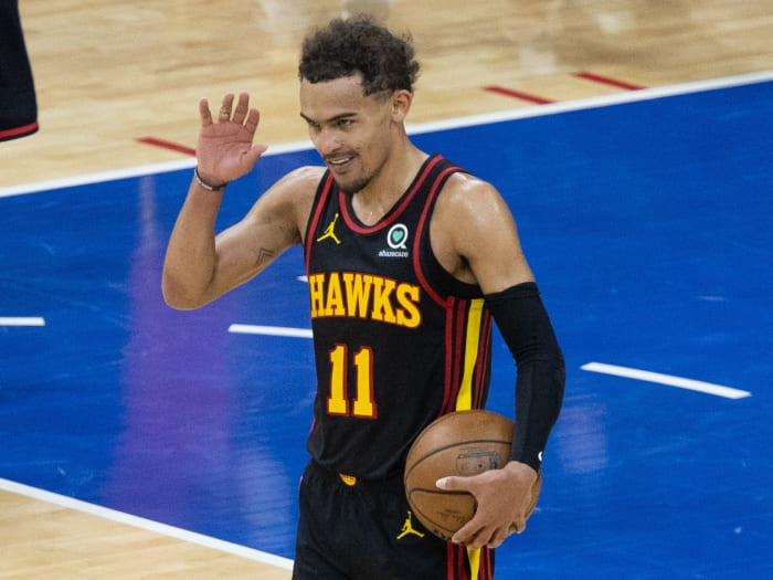 Atlanta Hawks guard Trae Young (11) reacts with fans in the final seconds of a win against the Philadelphia 76ers in Game 7 of the second round of the 2021 NBA Playoffs.