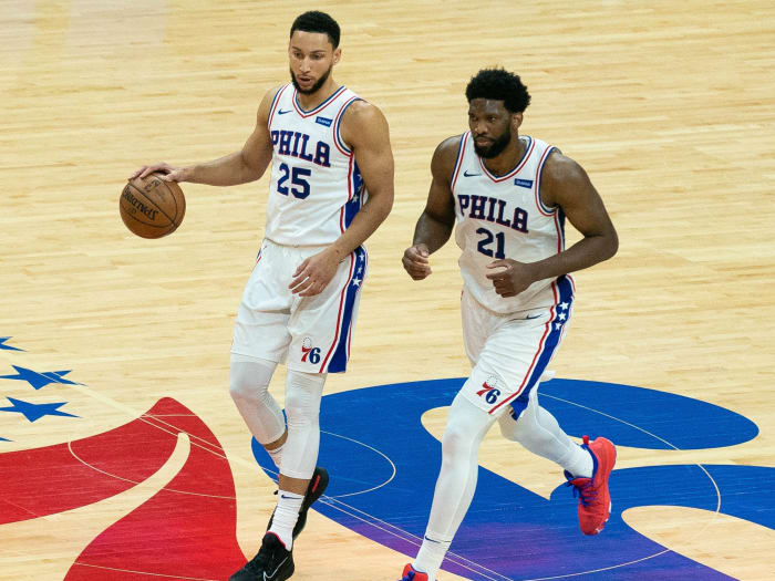 Philadelphia 76ers guard Ben Simmons (25) and center Joel Embiid (21) carry the ball onto the court against the Atlanta Hawks during the second quarter of the seventh game.