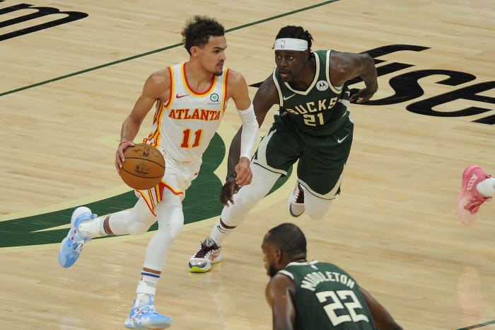 June 23, 2021;  Milwaukee, Wisconsin, United States;  Atlanta Hawks guard Trae Young (11) drives against Milwaukee Bucks guard Jrue Holiday (21) in the third quarter during Game 1 of the Eastern Conference Finals for the 2021 NBA Playoffs at the Fiserv Forum.  Mandatory Credit: Michael McLoone-USA TODAY Sports