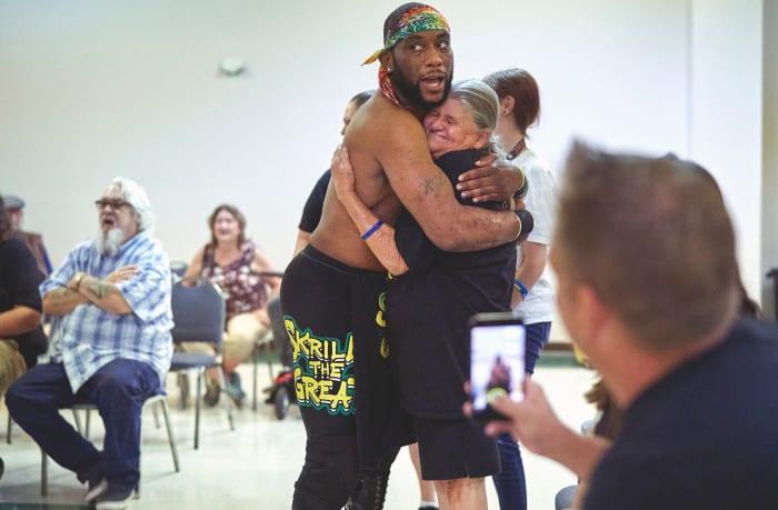 Skrilla the Great embraces a fan.